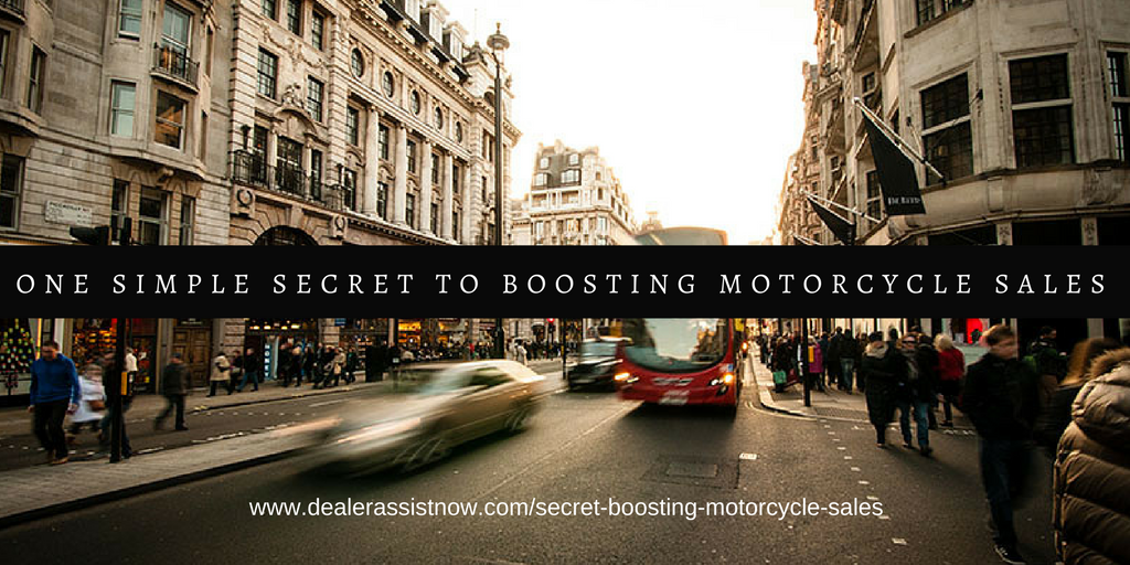 an image of a busy street with the text one simple secret to boosting motorcycle sales laid on top along with the link to our blog